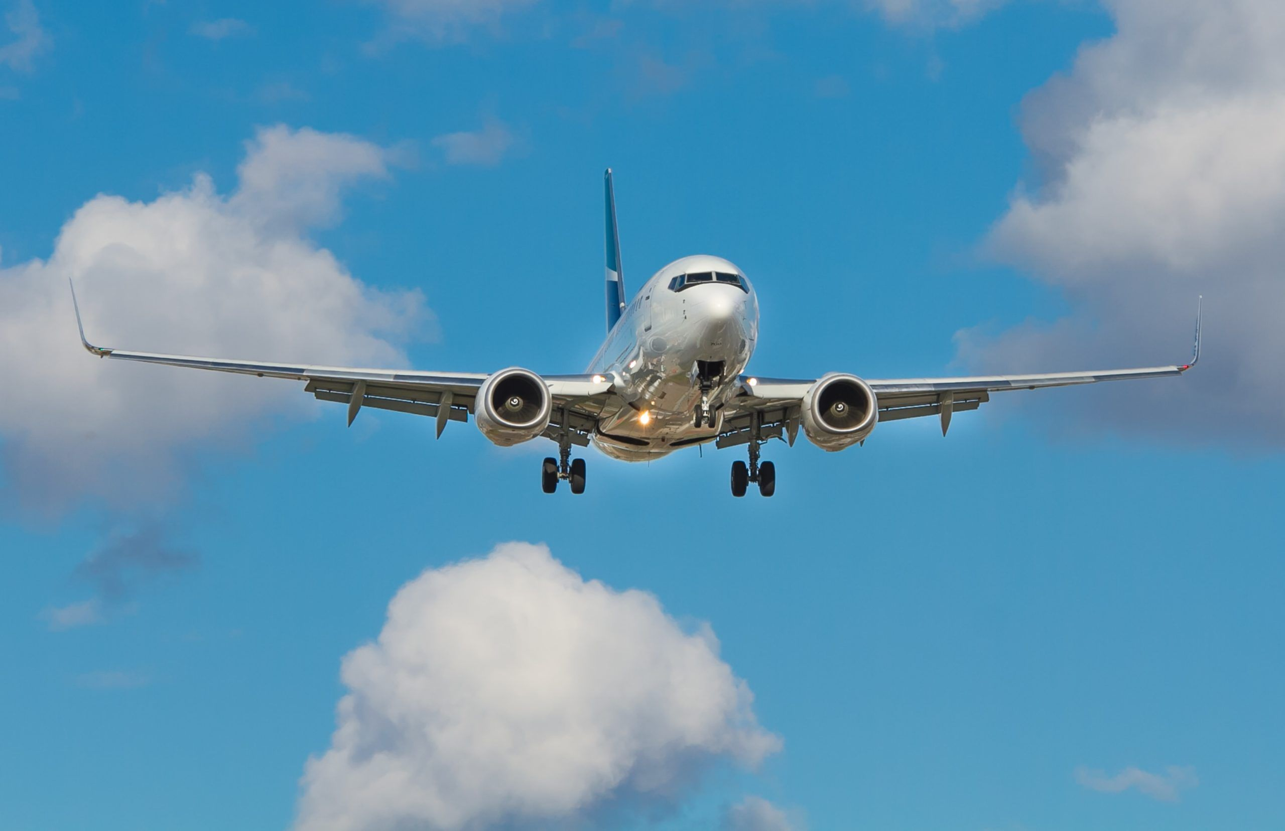 white airplane on mid air