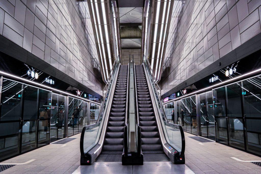 black and silver escalator in a building