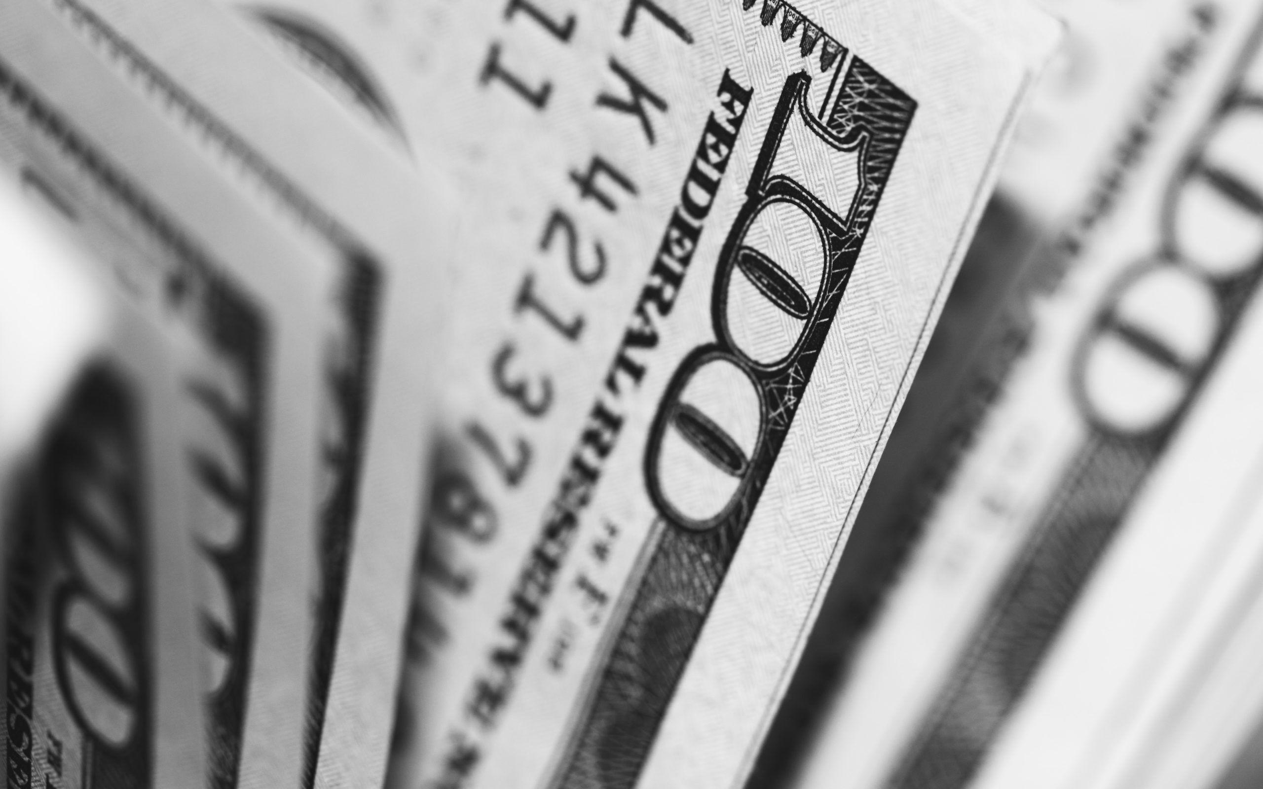 closeup photo of 100 US dollar banknotes